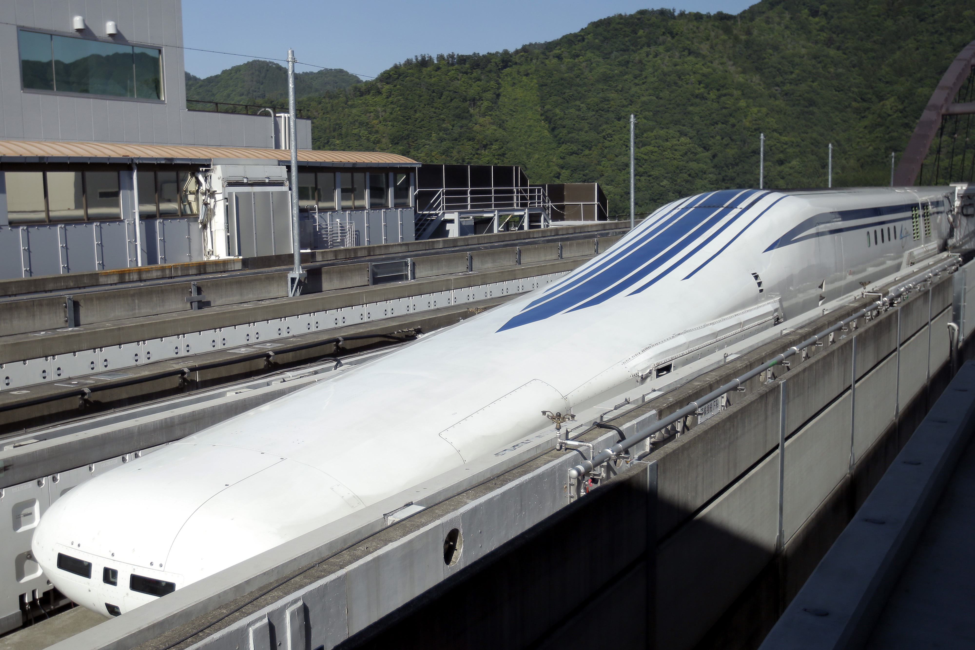 An L0 series magnetic levitation (maglev) train, developed by Central Japan Railway Co. (JR Central), sits on a track ahead of a trial run at the Yamanashi Maglev Test Track site in Tsuru, Yamanashi Prefecture, Japan, on Thursday, June 4, 2015. JR Central hopes to introduce maglev train simultaneously in Japan and U.S., Honorary Chairman Yoshiyuki Kasai said after riding the Maglev train with Maryland Governor Lawrence Hogan outside Tokyo. Photographer: Kiyoshi Ota/Bloomberg